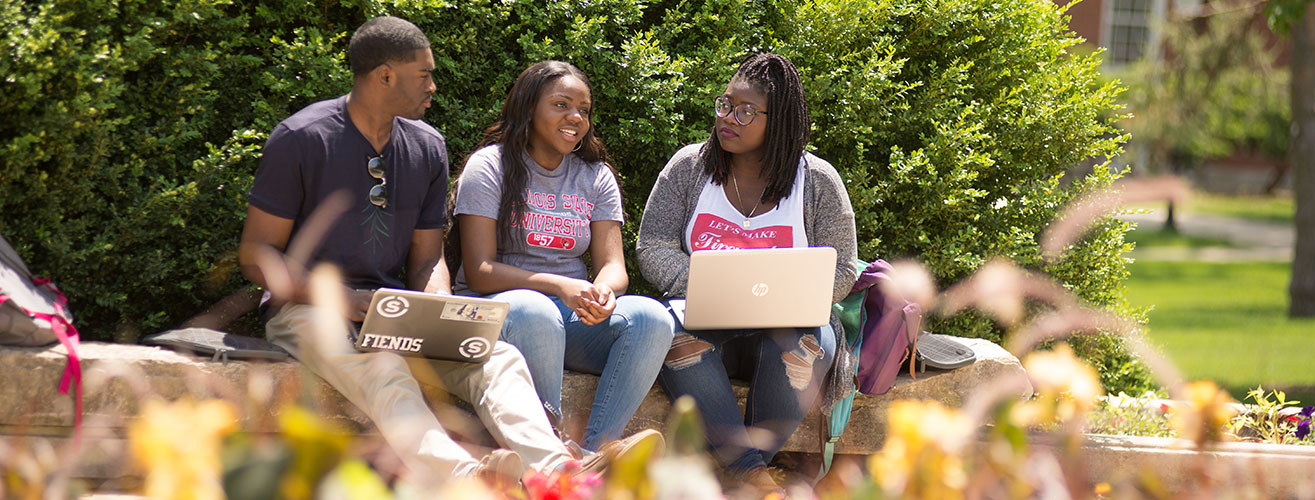 3 African American ISU Students Sitting Outside with Computers